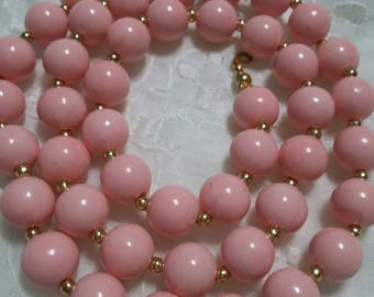 Powder pink unknown plastic and gold bead vintage necklace
