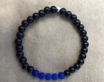 Support the Fallen - blue jade accented with black stones