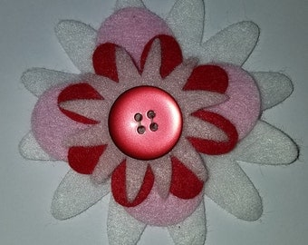 red and white flower hair pin