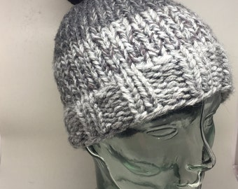 Hand knitted Ombré grey winter hat with a black pompom. Super warm.