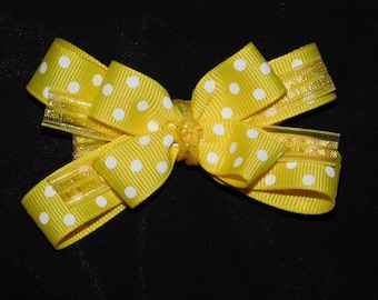Yellow hair bow with polka dots