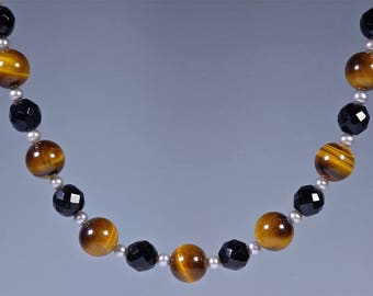 Tiger eye, jet, fresh water pearl necklace. Yellow tiger eye round beads, facetted jet beads and pearl beaded necklace, magnetic clasp.