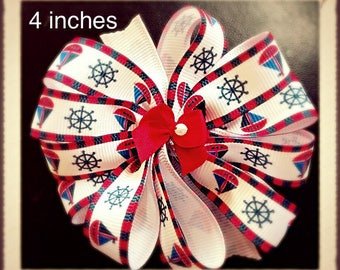 Nautical, 4 inch pinwheel boutique hair bow.  Nautical theme.  Red, white and blue