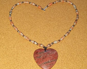 Handmade red - grey recycled paper bead necklace with a big red agate heart pendant