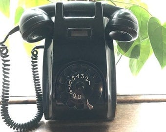 Vintage telephone for hanging against the wall, made of baceliet, from the sixties