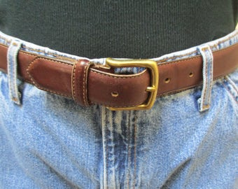 Coach brown leather belt size 34 size 85 with stitching detail on edges and solid brass buckle