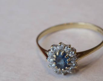 9 ct gold ring with blue and white stones.