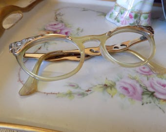 Retro cat eye horn rimed glasses in a gold tone and Lucite