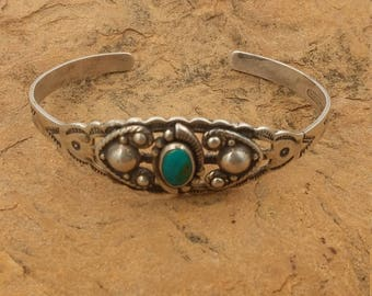 turquoise tourist braclet, sterling silver, has been repaired u can see the repair places on the back, still looks good makers mark on back