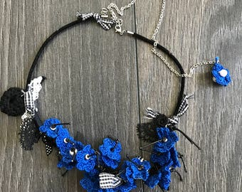 Crochet flowers necklace with leather strap and silver clasp