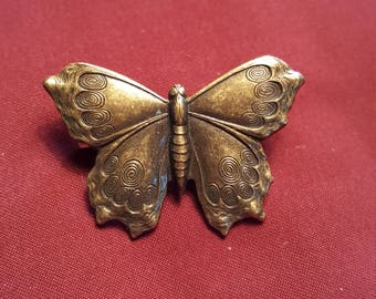 Beautiful butterfly pin with art deco design on wings