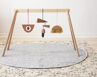 wooden play gym with hanging toys
