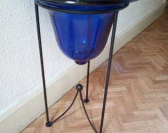 Blue glass on wrought iron stand Bowl