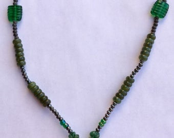 Beaded Necklace With Dinosaur Pendant