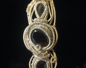 Pushti marg~ wire wrap: containing- opal,moldavite,smokey,and tourmaline