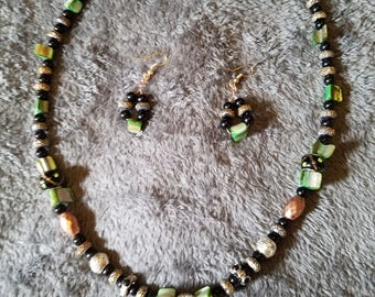 Striking black, green, and copper necklace and earring set will get you noticed