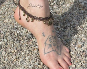 size-adjustable anklets in dark brown with bronze rings and bells