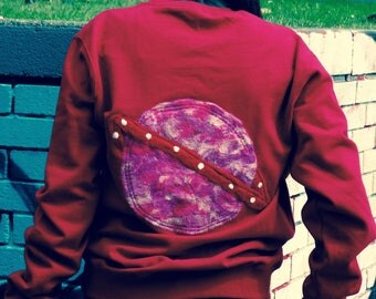 "Limited Edition, ""Outta this world"" colour block planet sweater."