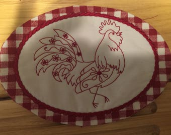 Embroidered mug rugs or coasters with rooster design.