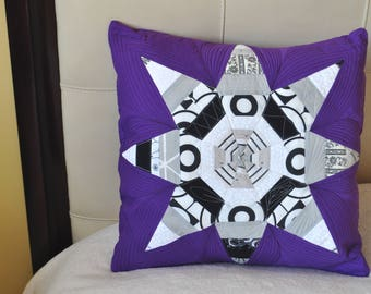 Quilted, colorful, decorative, pillow case in purple, black and white