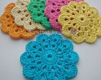 100% cotton crocheted flower drinks coasters/mats x6. Handmade. Protection. Blue. Yellow. Pink. Green. Cream. Orange. 12cm-13cm diameter.