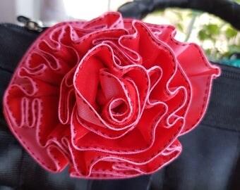 Handmade ribbon rosette for Harveys seatbelt bag