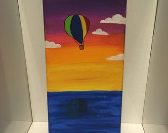 Hot air balloon over sunset canvas