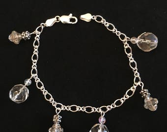 Sterling silver charm bracelet with clear crystal cut balls and antiqued dangles