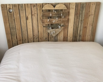Bed head with heart illuminated wooden pallets