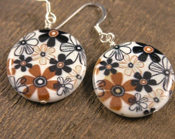 Brown and black flowers on large white shell beads handmade silver earrings