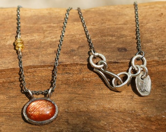 Oval sunstone necklace in silver bezel setting with yellow multi sapphire side set and oxidized sterling silver chain