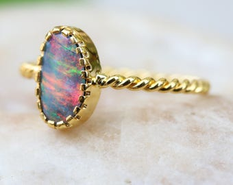 Gray Australian opal ring in pink,green fire in prongs setting with 18k gold twist band