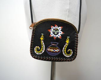 painted sun and snakes . tooled leather . small crossbody / shoulder bag