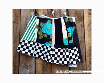 """Skirt """"Contrasts"""" with grey, flowers and checks, size 38"""