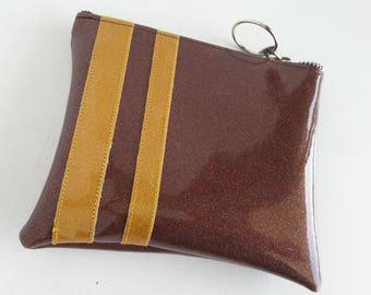 Brown metalflake vinyl make up bag with gold stripes