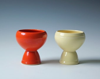 Two vintage ceramic pottery dessert cups orange and yellow; USA pottery pedestal cup pair