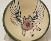 plate with flying pig slip trailed pottery