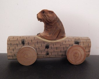 Hand Carved Beaver in a Log Car Wood Carving