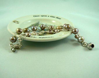 Blush Pearl Triple Strand Sterling Bracelet