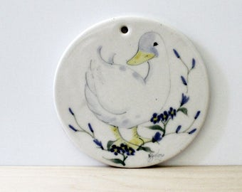 Happy Duck. 1980s ceramic wall tile.