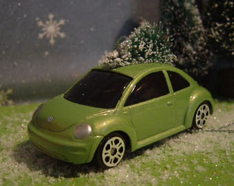 VW Beetle car with Christmas tree top ornament