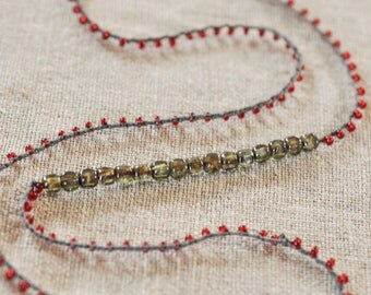 ruby red crocheted beaded necklace with irridescent gray-green bar