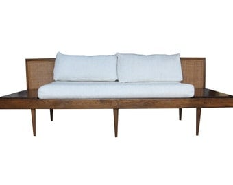 Mid century platform sofa with attached floating end tables