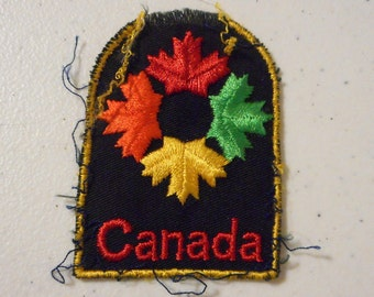 Vintage Canada Embroidered Sew On Patch Distressed Maple Leaf Black Red Orange Green