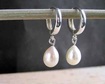 Teardrop white freshwater pearls on sterling silver european hoops.