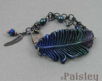 Jewel Tones Feather bracelet, metallic rainbow polymer clay feather on matte black plated chain with lobster clasp