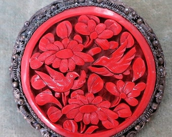 An Antique Cinnabar and Sterling Pin from China