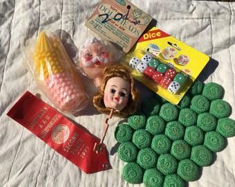 Destash Mixed Lot Vintage--Walbead Doll Head--Girl Doll Head-1971 Red Ribbon--11 Dice--Crocheted Green Hotpad-12 Pink & Yellow Umbrellas