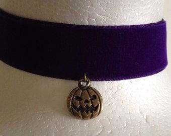 Royal purple velvet choker with bronze jackolanlern charm