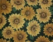 3/4 yard of green cotton fabric with yellow sunflowers